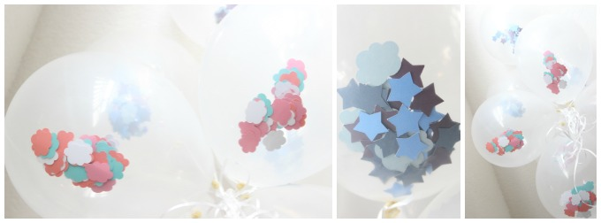 Clear balloons filled with clouds and stars for a baby shower