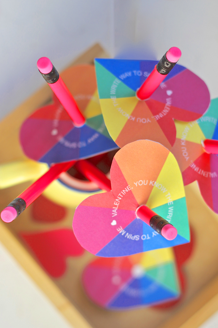 A bouquet of rainbow heart spinner Valentines, would be so sweet to hand out in class