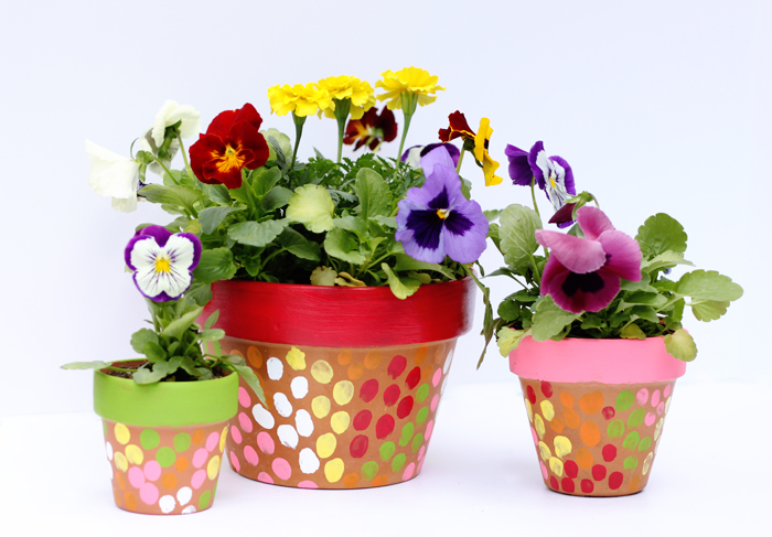 kid painted flower pots - these would make such great Mother's Day gifts