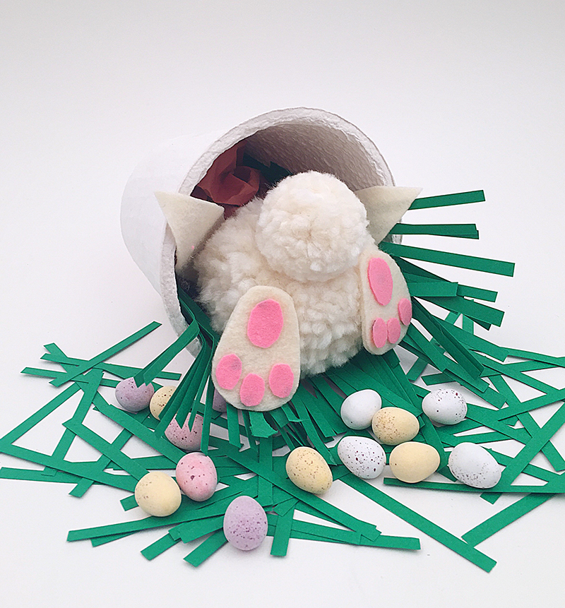 Adorable pom pom bunny bottom for an Easter basket or table