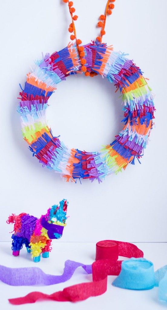 Make this piñata inspired fiesta wreath for your cinco de mayo party