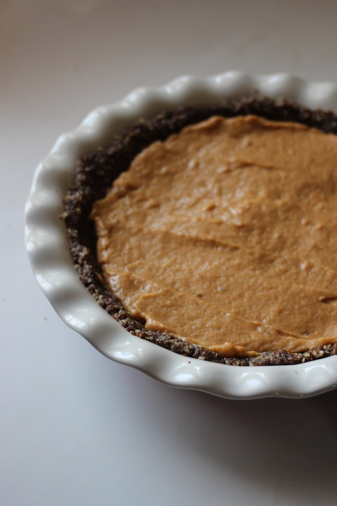 No-bake vegan pumpkin pie everyone at your table will love. A rich nut-date crust with silky smooth vegan pumpkin pie filling, topped with coconut whipped cream.