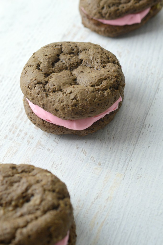 Homemade chocolate whoopie pies with creamy strawberry frosting, yes please! Whoopie pie recipe in post!