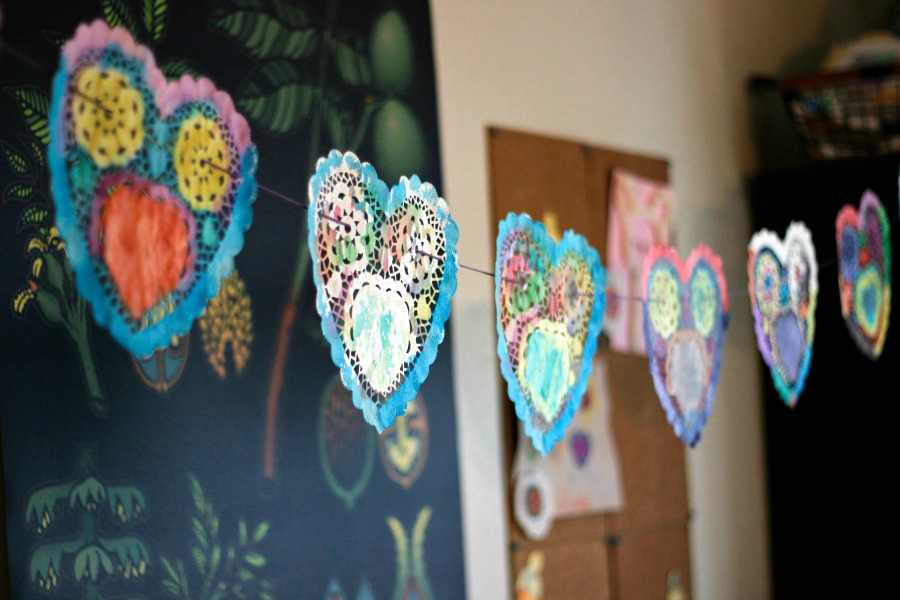 watercolor heart garland made with inexpensive heart doilies from the dollar store