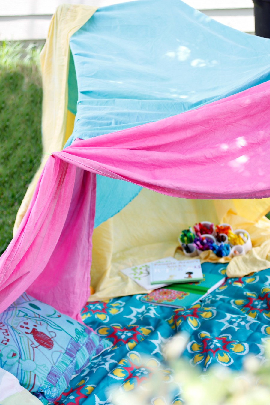 backyard forts make the perfect reading and coloring spot, we keep a fort kit by the door so the kids can build one whenever they want