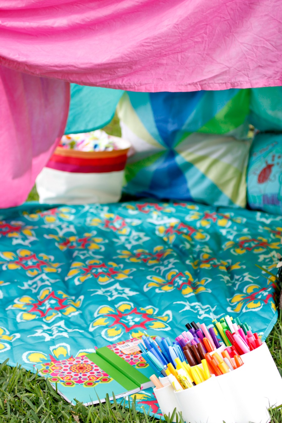 blanket fort coloring spot in the backyard -- great idea for a lazy summer afternoon